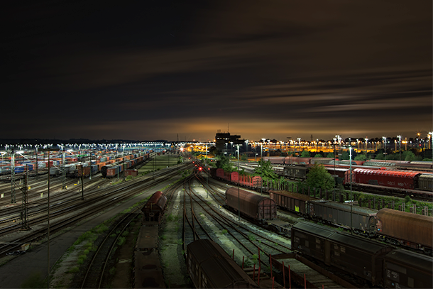 Rail yard full of trains on train tracks